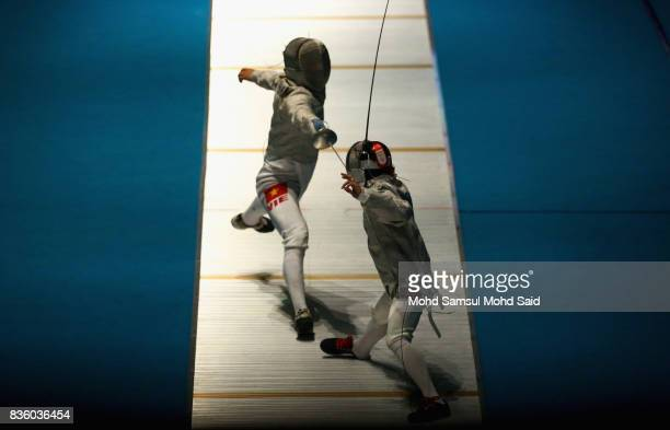 Vu Thanh An of Vietnam competes against Eric Brando of Philppines during the Men's Sabre Individual fencing match at the 2017 SEA Games on August 21...