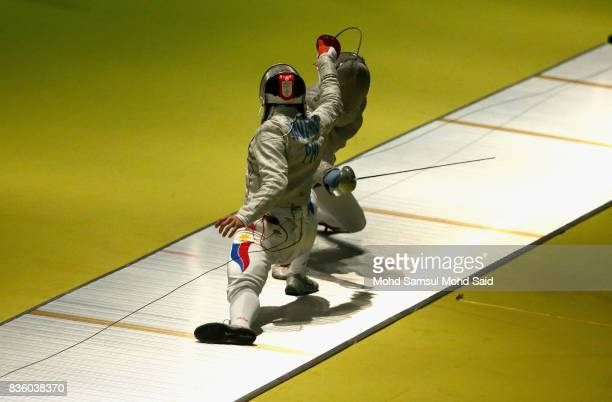 Vu Thanh An of Vietnam competes against Khim Sammean of Cambodia during the Men's Sabre Individual fencing match at the 2017 SEA Games on August 21...