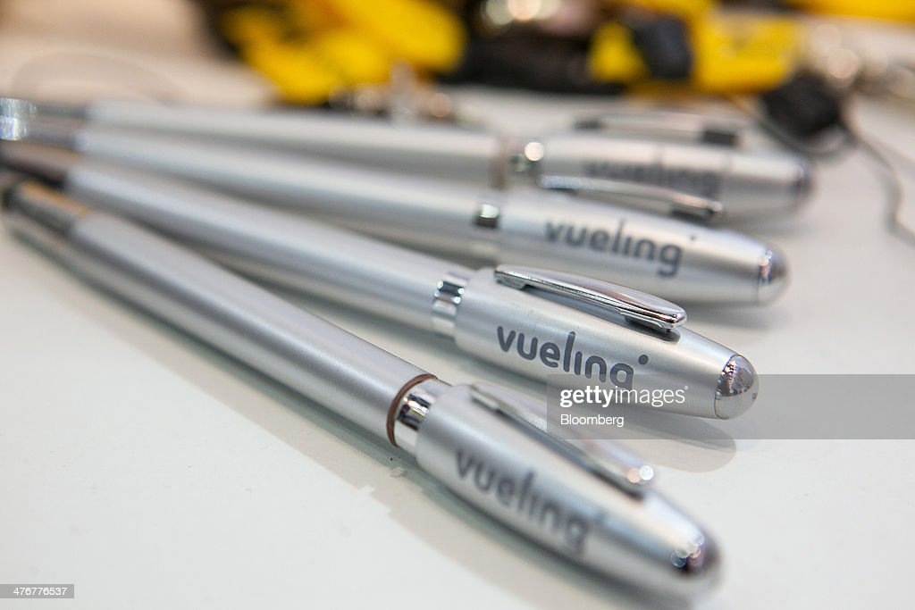 Vueling Airlines SA branded pens are seen at the ITB Berlin tourism fair at Messe Berlin exhibition center in Berlin, Germany, on Wednesday, March 5, 2014. Archaic rules, taxes as high as those imposed on alcohol and an infrastructure deficit, especially in Asia, are curbing the aviation industry's growth, the International Air Transport Association said. Photographer: Krisztian Bocsi/Bloomberg via Getty Images