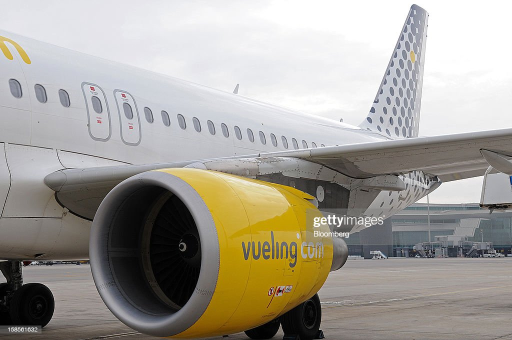A Vueling Airlines SA logo is seen on an Airbus A320 engine cowling at EL Prat airport in Barcelona, Spain, on Wednesday, Dec. 19, 2012. International Consolidated Airlines Group SA won't require European Union approval to buy 100 percent of low-cost carrier Vueling Airlines SA, the EU's antitrust chief said. Photographer: Stefano Buonamici/Bloomberg via Getty Images