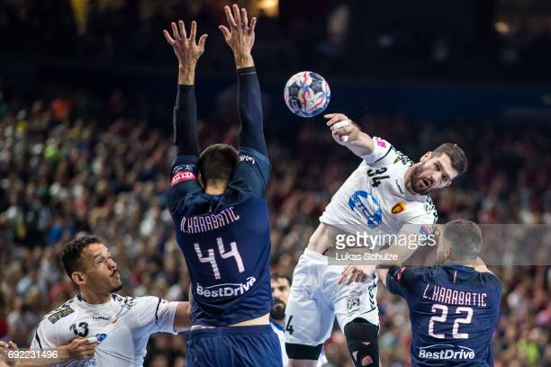 Vuko Borozan of Vardar is attacked by Nikola Karabatic and Luka Karabatic of Paris during the VELUX EHF FINAL4 Final match between Paris SaintGermain...