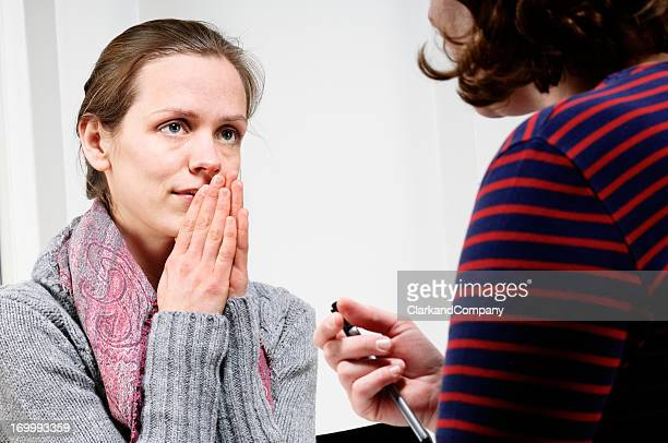 Vulnerable Young Woman Talking To a  Counsellor