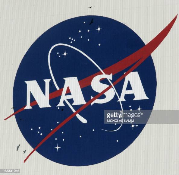 Vultures fly past a NASA logo on the Vehicle Assembly Building at Kennedy Space Center after a 24hour delay of the launch of US space shuttle...