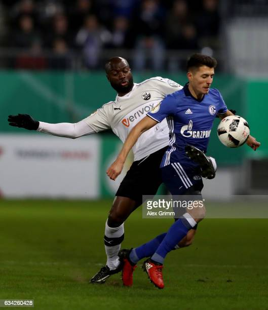Vunguidica of Sandhausen and Alessandro Schoepf of Schalke battle for the ball during the DFB Cup Round of16 match between SV Sandhausen and FC...