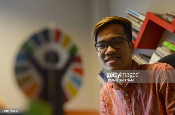 Vuong Kha Phong a Vietnamese gay activist and LGBT rights programme assistant speaks during an interview with AFP about Taiwan's gay marriage ruling...