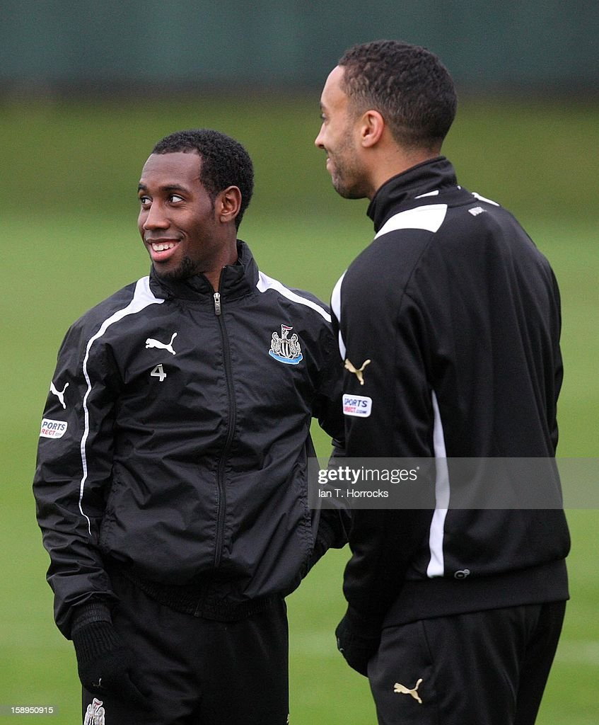 Vurnon Anita (L) and James Perch talk during a Newcastle United training session at The Little Benton training ground on January 04, 2013 in Newcastle upon Tyne, England.
