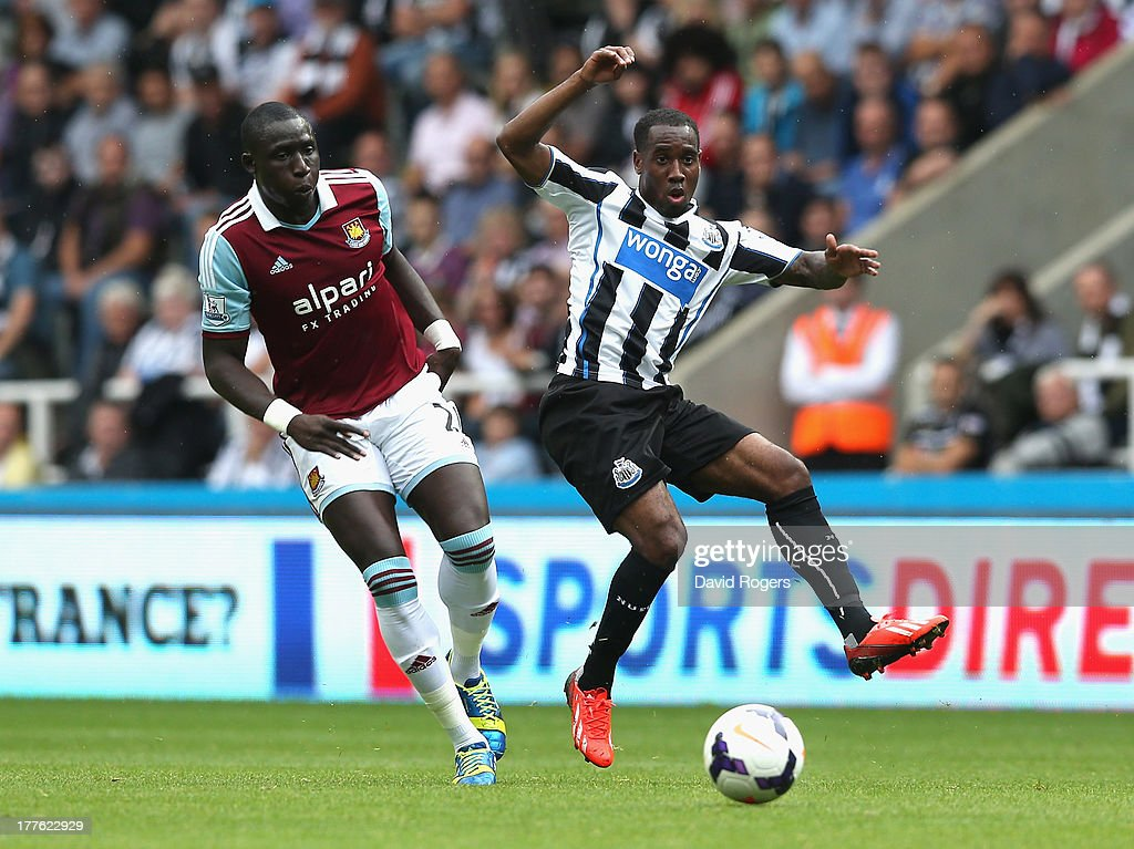 Vurnon Anita of Newcastle is challenged by Mohamed Diame during the Barclays Premier League match between Newcastle United and West Ham United at St James' Park on August 24, 2013 in Newcastle upon Tyne, England.