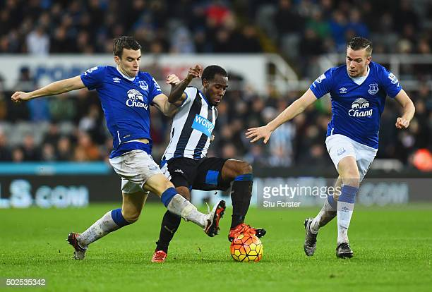 Vurnon Anita of Newcastle United battles with Seamus Coleman and Tom Cleverley of Everton during the Barclays Premier League match between Newcastle...