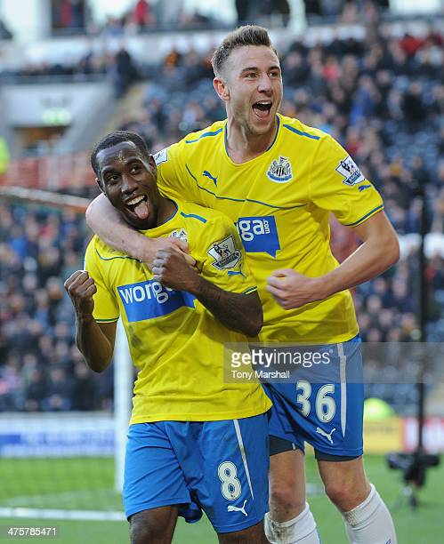 Vurnon Anita of Newcastle United celebrates scoring their fourth goal with Paul Dummett of Newcastle United during the Barclays Premier League match...