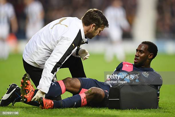 Vurnon Anita of Newcastle United receives a medical treatment during the Barclays Premier League match between West Bromwich Albion and Newcastle...