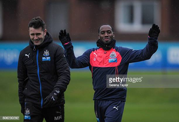 Vurnon Anita puts his hands in the air and waves whilst walking outside with Physiotherapist Michael Harding during the Newcastle United Training...