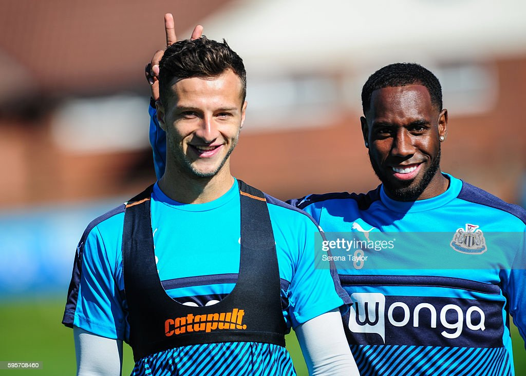 Vurnon Anita smiles and plays a joke on teammate Jamie Sterry during the Newcastle United Training Session at The Newcastle United Training Centre on...