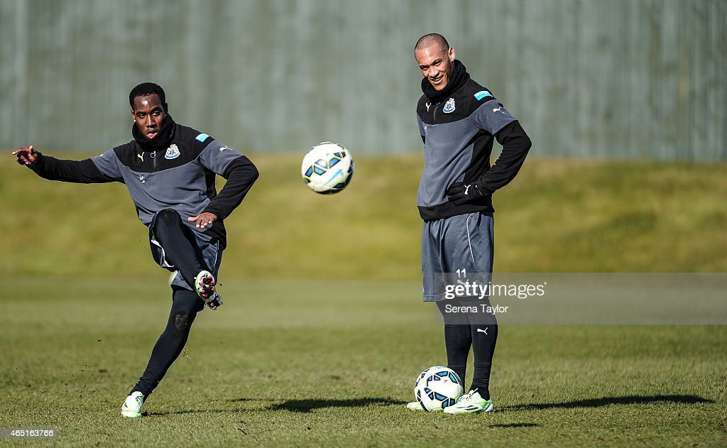 Vurnon Anita (L) strikes the ball as Yoan Gouffran (R) looks on during a Newcastle United Training session at The Newcastle United Training Centre on March 3, 2015, in Newcastle upon Tyne, England.
