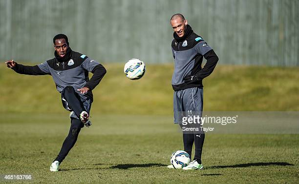 Vurnon Anita strikes the ball as Yoan Gouffran looks on during a Newcastle United Training session at The Newcastle United Training Centre on March 3...
