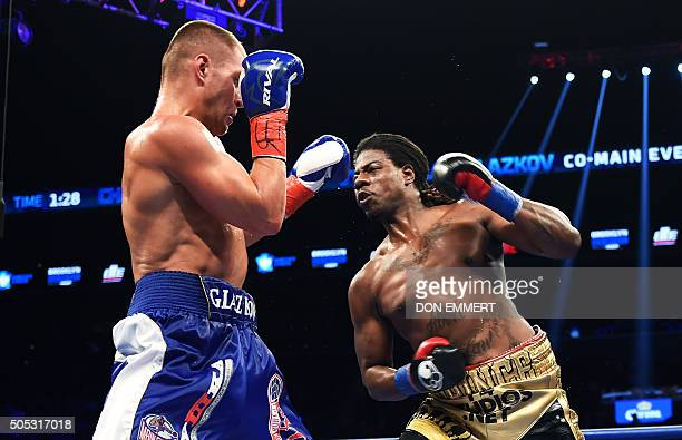 Vyacheslav Glazkov of the Ukraine defends against Charles Martin of the US during their IBF World Heavyweight Championship bout at Barclay's Center...