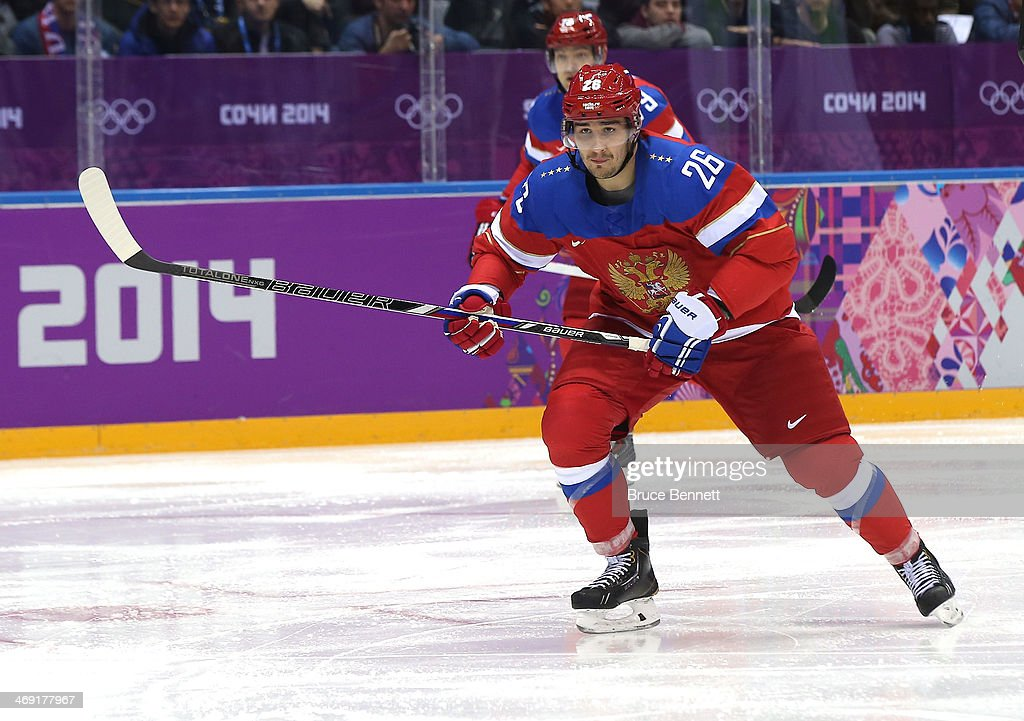 Vyacheslav Voynov of Russia skates against Slovenia during the Men's Ice Hockey Preliminary Round Group A game on day six of the Sochi 2014 Winter...