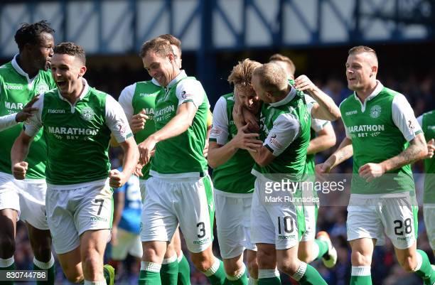 Vykintas Slivka of Hibernian celebrates scoring with his team mates during the Ladbrokes Scottish Premiership match between Rangers and Hibernian at...