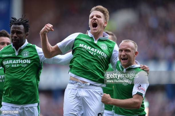 Vykintas Slivka of Hibernian celebrates scoring with team mate Dylan McGeouch during the Ladbrokes Scottish Premiership match between Rangers and...