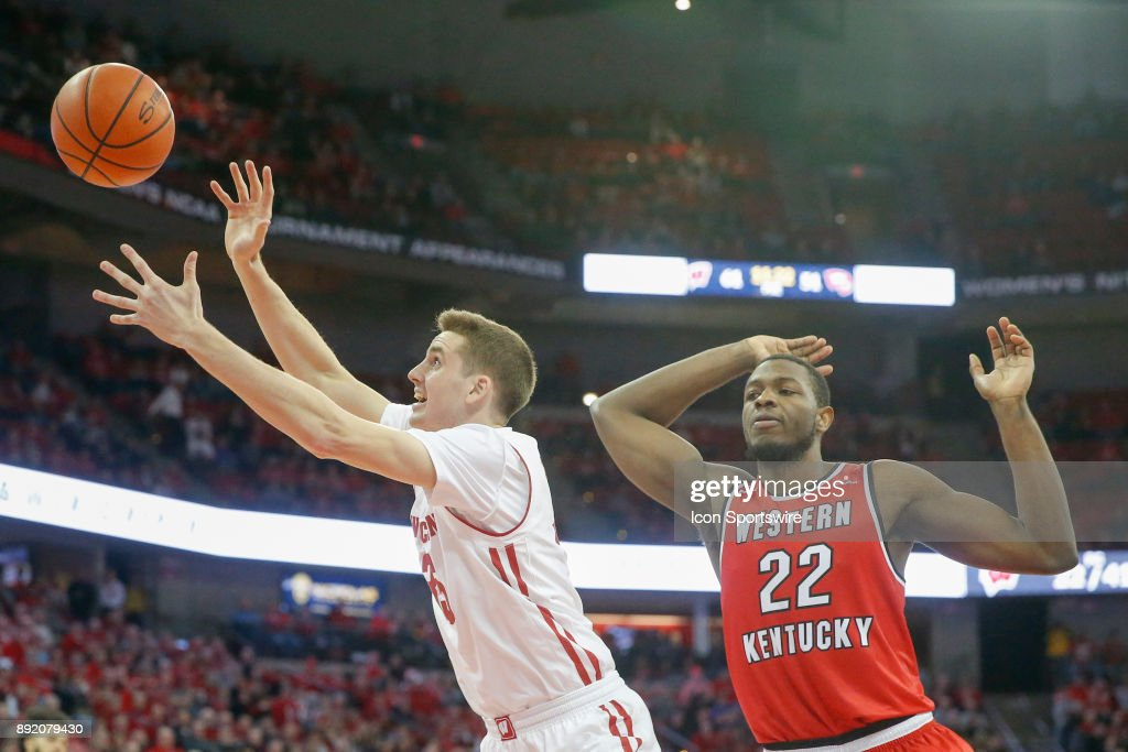 .w35 tries to keep the ball in bounds in front of Western Kentucky forward Dwight Coleby (22) during a college basketball game between the University of Wisconsin Badgers and the Western Kentucky University Hilltoppers on December 13, 2017 at the Kohl Center in Madison, WI.