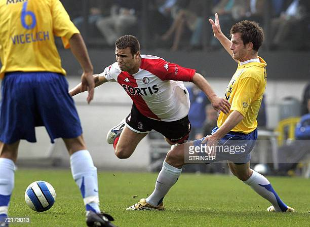 Feyenoord's Ali Boussaboun falls over the knee of Waalwijk 's Stephan Keller 15 October 2006 in Netherlands ' L1 match opposing RKC Waalwijk vs...
