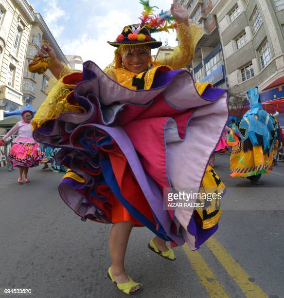 Waca Waca Vacunos dancers take part in the opening parade of the Jesus del Gran Poder festival in La Paz on June 10 2017 Some 40000 dancers grouped...
