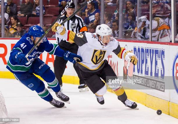 Wacey Hamilton of the Vancouver Canucks tries to knock BrendanÊLeipsicÊ#13 of the Las Vegas Golden Knights off the puck in NHL preseason action on...