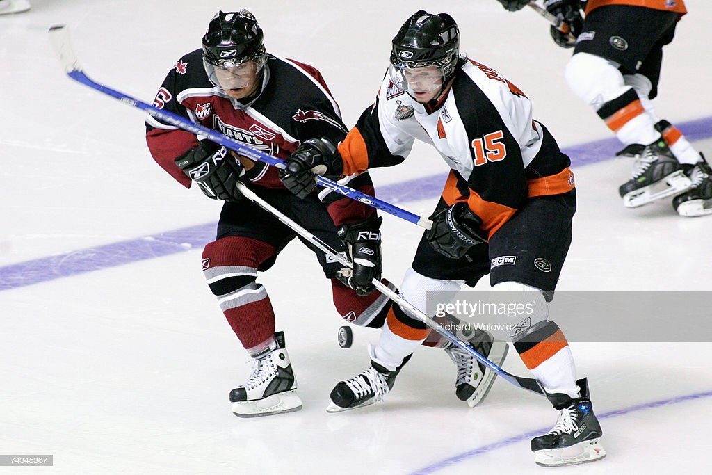 Wacey Rabbit of the Vancouver Giants battles for the puck with Derek Dorsett of the Medicine Hat Tigers during the final game of the 2007 Mastercard...