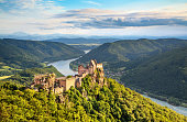 Beautiful landscape with Aggstein castle ruin and Danube river at sunset in Wachau, Austria.