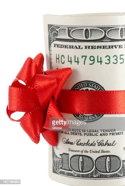 Wad of 100-dollar bills with red ribbon and bow