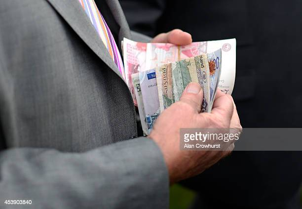 A wad of money in the betting ring at York racecourse on August 21 2014 in York England