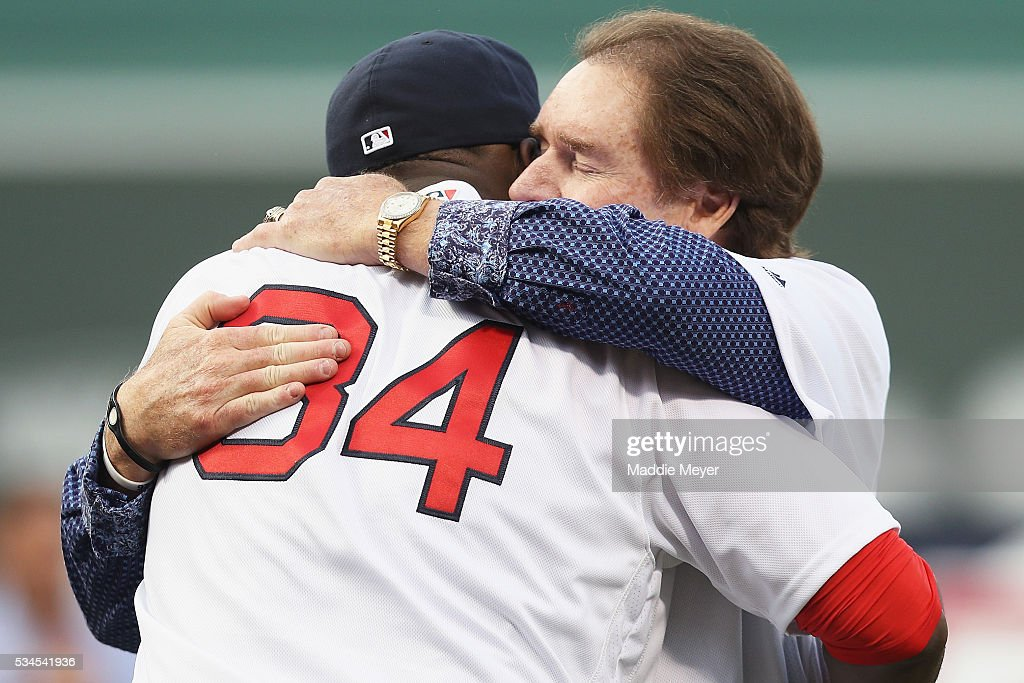 <a gi-track='captionPersonalityLinkClicked' href=/galleries/search?phrase=Wade+Boggs&family=editorial&specificpeople=209175 ng-click='$event.stopPropagation()'>Wade Boggs</a> hugs <a gi-track='captionPersonalityLinkClicked' href=/galleries/search?phrase=David+Ortiz&family=editorial&specificpeople=175825 ng-click='$event.stopPropagation()'>David Ortiz</a> #34 of the Boston Red Sox during his uniform number 26 retirement ceremony prior to the game between the Boston Red Sox and the Colorado Rockies at Fenway Park on May 26, 2016 in Boston, Massachusetts.