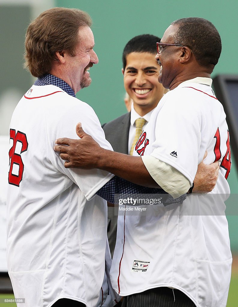 <a gi-track='captionPersonalityLinkClicked' href=/galleries/search?phrase=Wade+Boggs&family=editorial&specificpeople=209175 ng-click='$event.stopPropagation()'>Wade Boggs</a> hugs former teammate <a gi-track='captionPersonalityLinkClicked' href=/galleries/search?phrase=Jim+Rice&family=editorial&specificpeople=220917 ng-click='$event.stopPropagation()'>Jim Rice</a> at his uniform number 26 retirement ceremony prior to the game between the Boston Red Sox and the Colorado Rockies at Fenway Park on May 26, 2016 in Boston, Massachusetts.