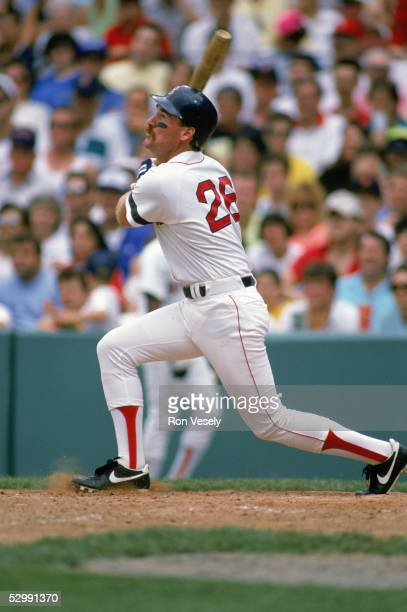 Wade Boggs of the Boston Red Sox bats during an MLB game at Fenway Park in Boston Massachusetts Boggs played for the Boston Red Sox from 19821992
