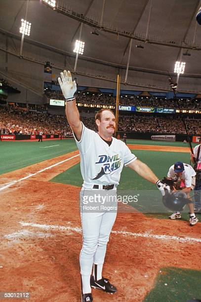 Wade Boggs of the Tampa Bay Devil Rays celebrates after making his 3000 hit during a game on August 71999 Wade Boggs played for the Tampa Bay Devil...