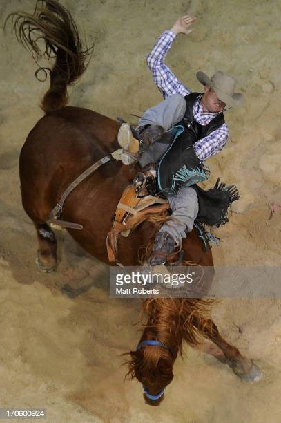 Wade Clifford of Gunnedah competes Bareback Bronc Riding during the National Rodeo Finals on June 15 2013 on the Gold Coast Australia
