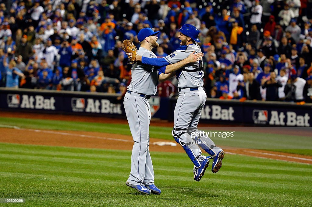 Wade Davis #17 and Drew Butera #9 of the Kansas City Royals celebrate after defeating the New York Mets in Game Five of the 2015 World Series at Citi Field on November 1, 2015 in the Flushing neighborhood of the Queens borough of New York City. The Kansas City Royals defeated the New York Mets with a score of 7 to 2 to win the World Series.