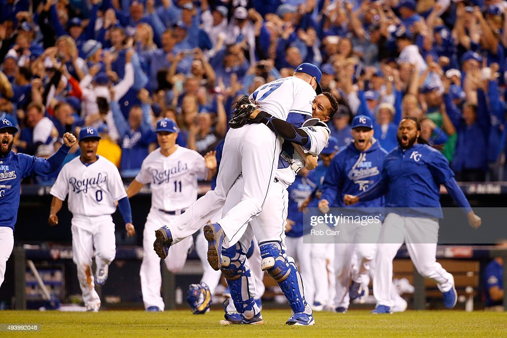Wade Davis #17 and Salvador Perez #13 of the Kansas City Royals celebrate after the Royals 4-3 victory against the Toronto Blue Jays in game six of the 2015 MLB American League Championship Series at Kauffman Stadium on October 23, 2015 in Kansas City, Missouri.