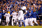 Wade Davis and Salvador Perez of the Kansas City Royals celebrate after the Royals 43 victory against the Toronto Blue Jays in game six of the 2015...