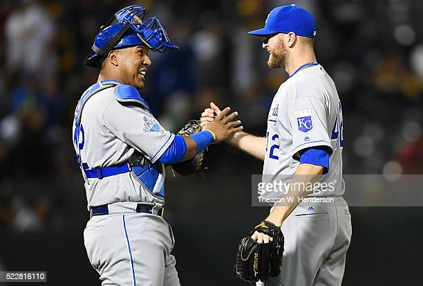 Wade Davis and Salvador Perez of the Kansas City Royals celebrates defeating the Oakland Athletics 42 at Oco Coliseum on April 15 2016 in Oakland...