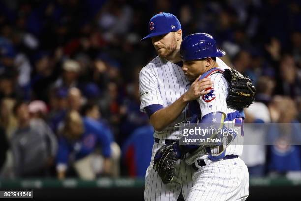 Wade Davis and Willson Contreras of the Chicago Cubs celebrate after beating the Los Angeles Dodgers 32 during game four of the National League...