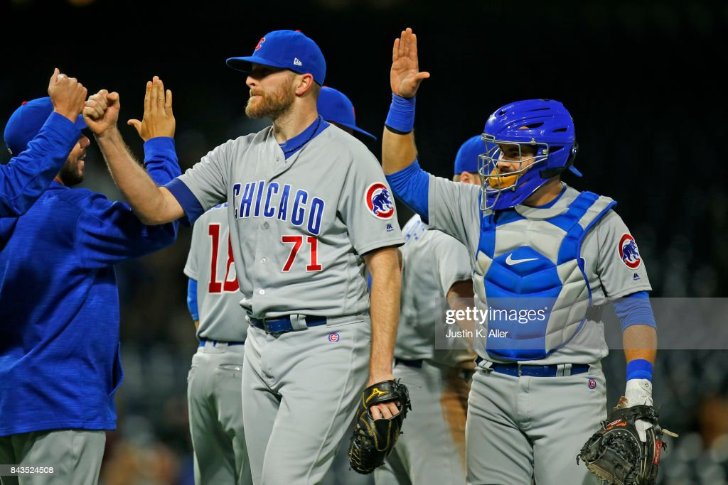 Wade Davis #71 of the Chicago Cubs celebrates with teammates after defeating the Pittsburgh Pirates 1-0 at PNC Park on September 6, 2017 in Pittsburgh, Pennsylvania.