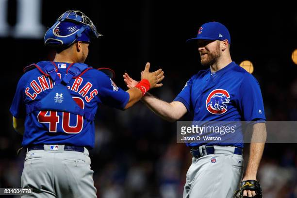 Wade Davis of the Chicago Cubs celebrates with Willson Contreras after the game against the San Francisco Giants at ATT Park on August 7 2017 in San...