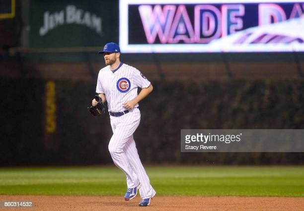 Wade Davis of the Chicago Cubs jogs onto the field in the eighth inning during game four of the National League Division Series against the...