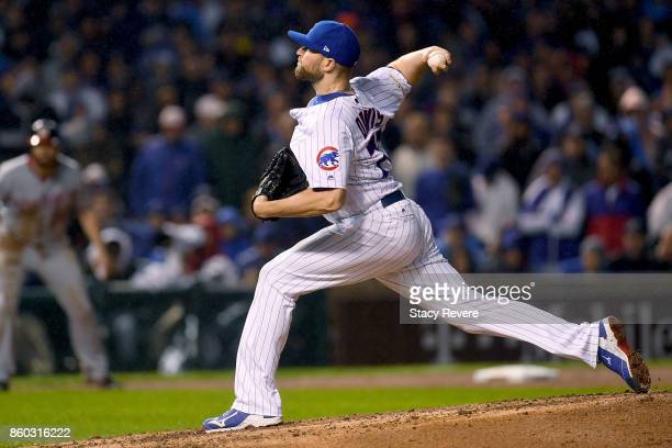 Wade Davis of the Chicago Cubs pitches in the eighth inning during game four of the National League Division Series against the Washington Nationals...