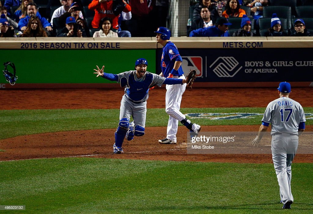 Wade Davis #17 of the Kansas City Royals celebrates with Drew Butera #9 of the Kansas City Royals after defeating the New York Mets to win Game Five of the 2015 World Series at Citi Field on November 1, 2015 in the Flushing neighborhood of the Queens borough of New York City. The Kansas City Royals defeated the New York Mets with a score of 7 to 2 to win the World Series.