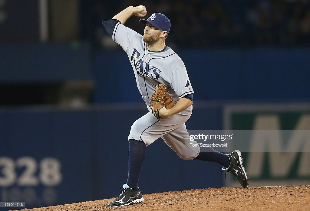 <a gi-track='captionPersonalityLinkClicked' href=/galleries/search?phrase=Wade+Davis+-+Baseball+Player&family=editorial&specificpeople=8202494 ng-click='$event.stopPropagation()'>Wade Davis</a> #40 of the Tampa Bay Rays delivers a pitch during MLB game action against the Toronto Blue Jays on August 30, 2012 at Rogers Centre in Toronto, Ontario, Canada.