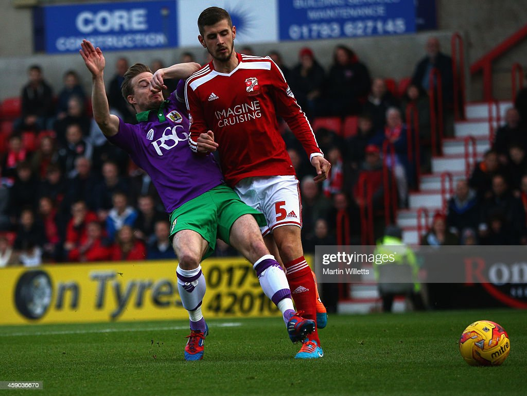 Wade Elliott of Bristol City clashes with Jack Stephens of Swindon Town in the incident just to prior to one that leads his red card during the Sky...