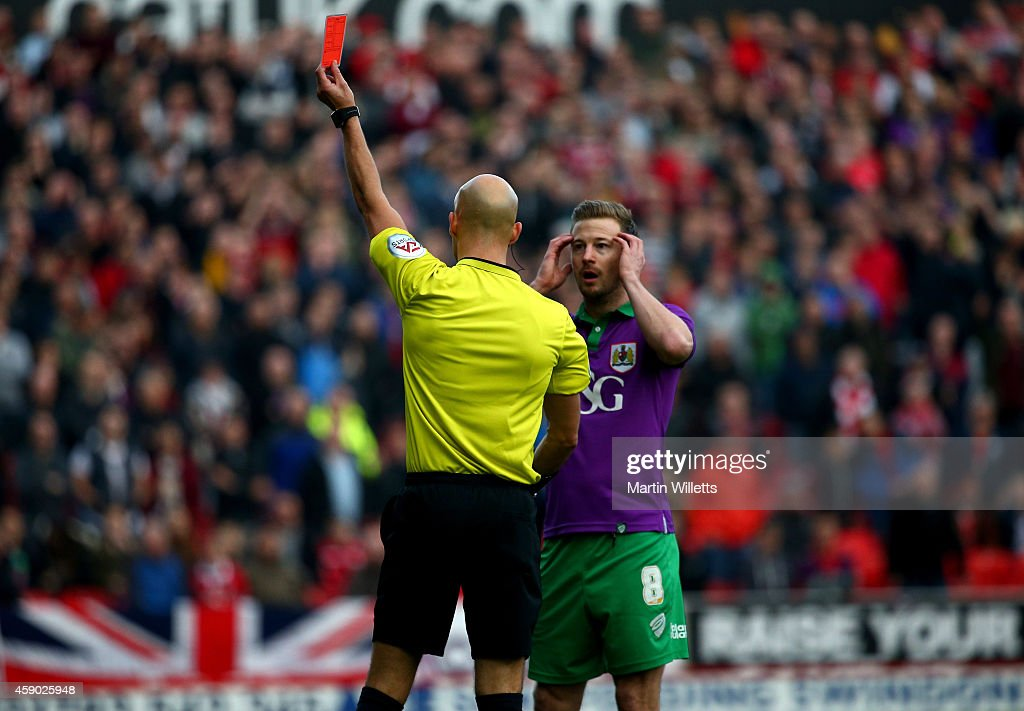 Wade Elliott of Bristol City reacts as he is sent off by referee Darren Drysdale during the Sky Bet League One match between Swindon Town and Bristol...