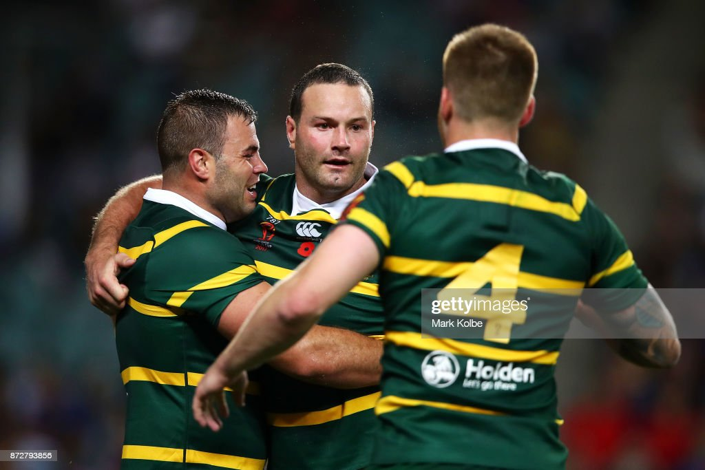 Wade Graham, Boyd Cordner and Cameron Munster of Australia celebrate Cordner scoring a try during the 2017 Rugby League World Cup match between Australia and Lebanon at Allianz Stadium on November 11, 2017 in Sydney, Australia.