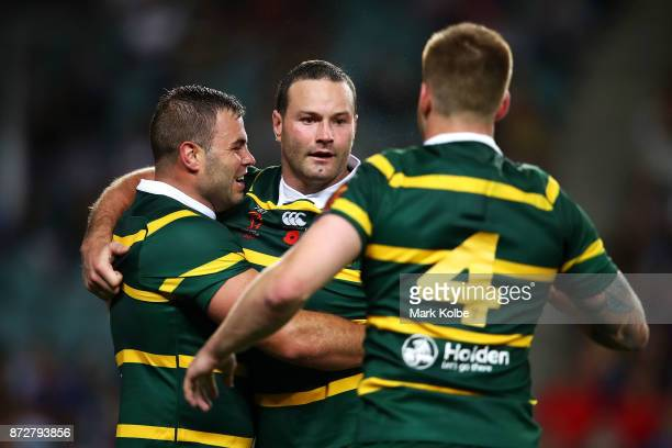 Wade Graham Boyd Cordner and Cameron Munster of Australia celebrate Cordner scoring a try during the 2017 Rugby League World Cup match between...